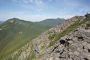 The rocky summit of Mount Flume during the summer months in the White Mountains of New Hampshire USA. Franconia Ridge can be see in the background.