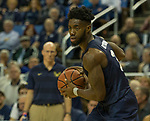 Akron forward Daniel Utomi (3) looks to pass against Nevada in the second half of an NCAA college basketball game in Reno, Nev., Saturday, Dec. 22, 2018. (AP Photo/Tom R. Smedes)