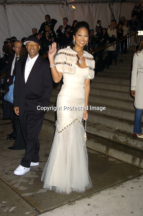 Russell and Kimora Lee Simmons ..at The Metropolitan Museum of Art's Costume Institute Gala ..celebrating Chanel on May 2, 2005 in New York City.    Photo by Robin Platzer, Twin Images