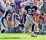 Oakland Raiders vs. Denver Broncos at Oakland Alameda County Coliseum Sunday, October 10, 1999.  Broncos beat Raiders  16-13.  Oakland Raiders defensive back Darrien Gordon (23) runs a way from Denver Broncos defensive back Chris Watson (21).