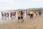 Competitors run along Ballyheigue beach last Saturday in the Sandstorm challenge