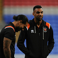 Blackpool's Curtis Tilt shares a joke with Sean Scannell<br /> <br /> Photographer Kevin Barnes/CameraSport<br /> <br /> The EFL Sky Bet League One - Bolton Wanderers v Blackpool - Monday 7th October 2019 - University of Bolton Stadium - Bolton<br /> <br /> World Copyright © 2019 CameraSport. All rights reserved. 43 Linden Ave. Countesthorpe. Leicester. England. LE8 5PG - Tel: +44 (0) 116 277 4147 - admin@camerasport.com - www.camerasport.com