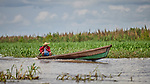 A boat cruises along the Javari River at Atalaia do Norte in Brazil's Amazon region.