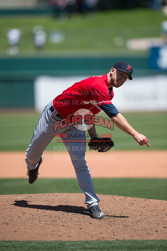 Tacoma Rainiers relief pitcher Lindsey Caughel (13) follows through on his delivery during a Pacific Coast League against the Sacramento RiverCats at Raley Field on May 15, 2018 in Sacramento, California. Tacoma defeated Sacramento 8-5. (Zachary Lucy/Four Seam Images)