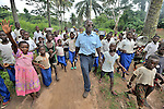 Jacques Umembudi Akasa, a United Methodist missionary pilot for Wings of Caring Aviation, a program of the United Methodist Church in the Democratic Republic of the Congo, is welcomed to the village of Tunda by children who ran to the airstrip to greet his plane.