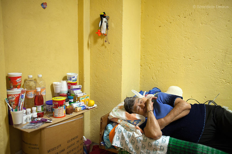 Carmelita, a resident of Casa Xochiquetzal, rests in her bedroom at the shelter in Mexico City on November 1, 2012. Casa Xochiquetzal is a shelter for elderly sex workers in Mexico City. It gives the women refuge, food, health services, a space to learn about their human rights and courses to help them rediscover their self-confidence and deal with traumatic aspects of their lives. Casa Xochiquetzal provides a space to age with dignity for a group of vulnerable women who are often invisible to society at large. It is the only such shelter existing in Latin America. Photo by Bénédicte Desrus