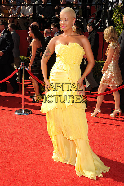 AMBER ROSE.18th Annual ESPY Awards - Arrivals held at Nokia Theatre L.A. Live, Los Angeles, California, USA..July 14th, 2010.espys full length yellow strapless dress gown tiered layers layered tattoo.CAP/ADM/BP.©Byron Purvis/AdMedia/Capital Pictures.