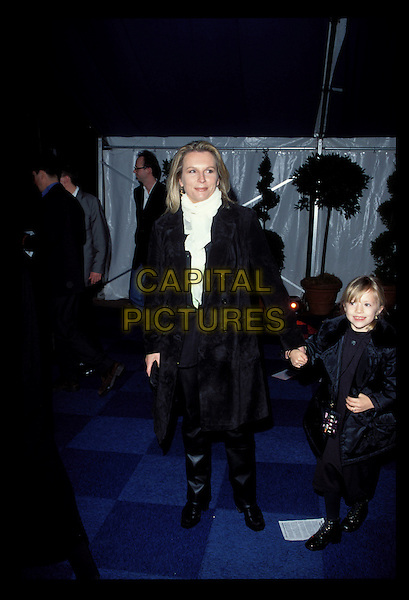 JENNIFER SAUNDERS.Ref:7063.sales@capitalpictures.com.www.capitalpictures.com.©Capital Pictures.black suede coat, white scarf, holding childs hand