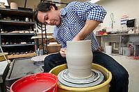 Ceramic Artist Jordan Smith works pottery wheel at Center for the Arts, Bonita Springs, Florida, May 21, 2012... photo by debi pittman wilkey.