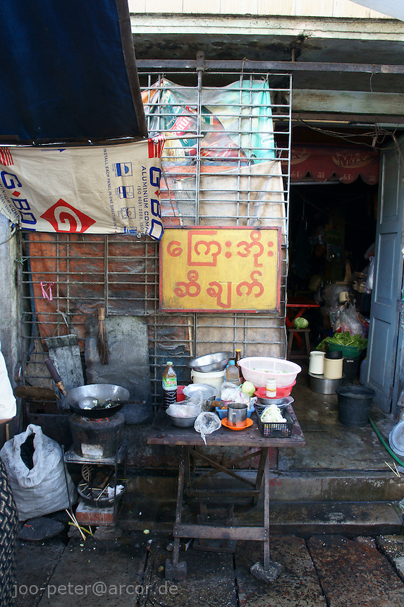kitchen area of a food place on the streets of Yangon, Myanmar, 2011