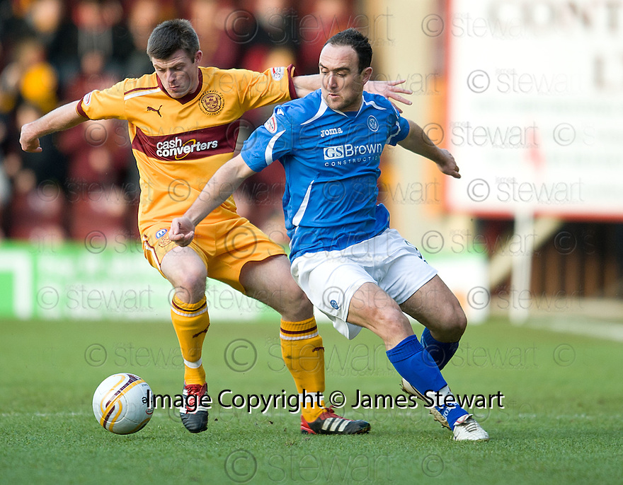 MOTHERWELL'S STEVEN JENNINGS AND ST JOHNSTONE'S LEE CROFT CHALLENGE FOR THE BALL