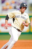Mac Williamson #7 of the Wake Forest Demon Deacons rounds third base in the top of the 9th inning against the LSU Tigers at Alex Box Stadium on February 20, 2011 in Baton Rouge, Louisiana.  The Tigers defeated the Demon Deacons 9-1.  Photo by Brian Westerholt / Four Seam Images