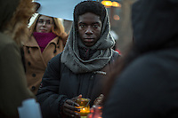 NEW YORK,NY December 16,2016: A young man with a candle stands for Aleppo during a vigil to protest against the Syrian government and the killing of innocent people in Washington Square Park, in New York City, December  16,2016. Photo by VIEWpress/Maite H. Mateo