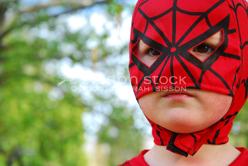 Boy dressed in spiderman mask close up