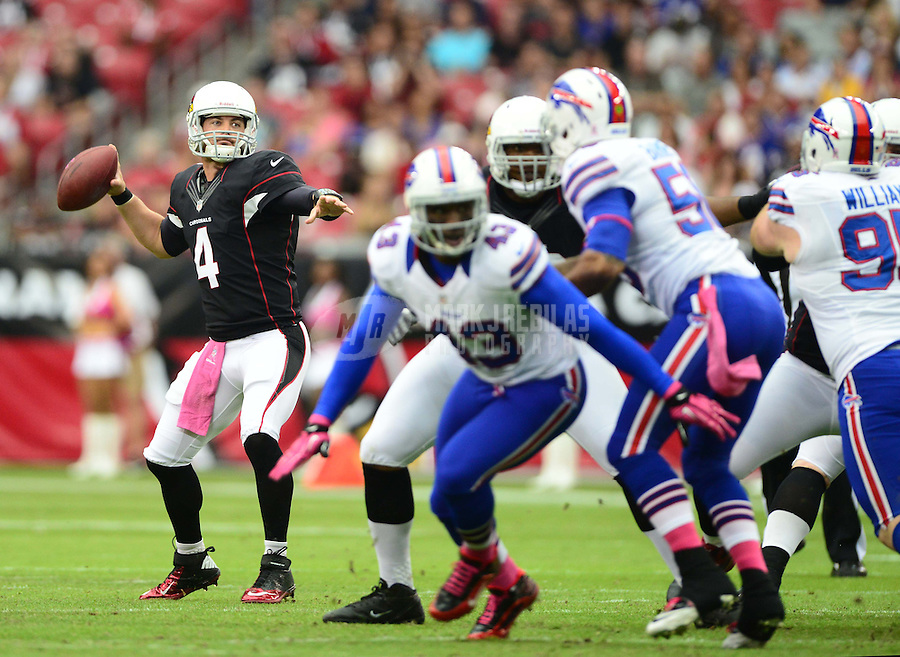Oct. 14, 2012; Glendale, AZ, USA; Arizona Cardinals quarterback (4) Kevin Kolb throws a pass in the first quarter against the Buffalo Bills at University of Phoenix Stadium. Mandatory Credit: Mark J. Rebilas-