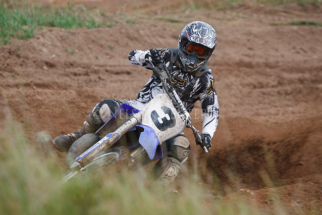 Motocross racer at a sharp turn on the course