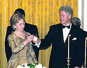 United States President Bill Clinton and first lady Hillary Rodham Clinton toast the 200th  Anniversary of the White House at a dinner in the East Room in Washington, DC on November 9, 2000. <br /> Credit: Ron Sachs / CNP