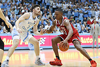 CHAPEL HILL, NC - FEBRUARY 25: C.J. Bryce #13 of North Carolina State University is defended by Andrew Platek #3 of the University of North Carolina during a game between NC State and North Carolina at Dean E. Smith Center on February 25, 2020 in Chapel Hill, North Carolina.