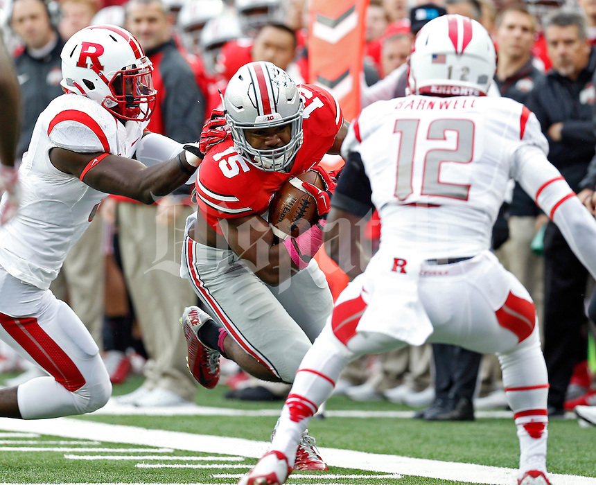 Ohio State Buckeyes running back Ezekiel Elliott (15) gets to the sideline against Rutgers Scarlet Knights defense during the 1st quarter of their game at Ohio Stadium on October 18, 2014.   (Dispatch photo by Kyle Robertson)