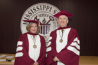 Faculty members Lori Bruce and Brent Funderburk in graduation regalia.<br />  (photo by Beth Wynn / &copy; Mississippi State University)