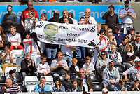 """FAO SPORTS PICTURE DESK<br /> Pictured: Swansea supporters with a """"What Brendan Wanst Brendan Gets banner"""" for his request for fans to dress up as Elvis Presley. Sunday, 13 May 2012<br /> Re: Premier League football, Swansea City FC v Liverpool FC at the Liberty Stadium, south Wales."""