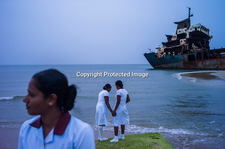 Health workers stand on the beach next to the wrecked ship where the final battle between the LTTE and the Sri Lankan army took place in Vellamullivaikal in Kilinochchi in Northern Sri Lanka. Photo: Sanjit Das/Panos