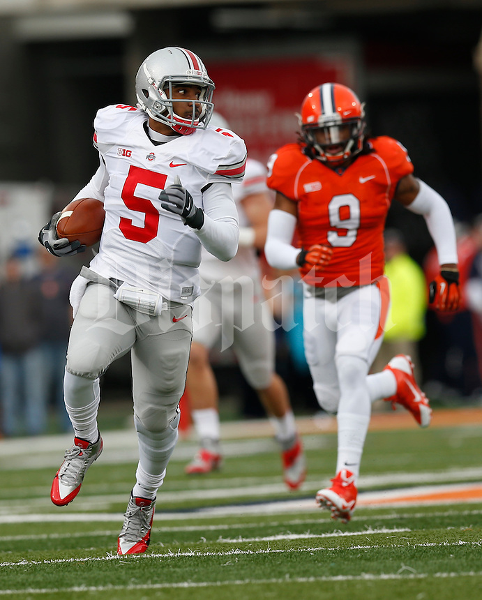 Ohio State Buckeyes quarterback Braxton Miller (5) evades Illinois Fighting Illini defensive back Earnest Thomas III (9) and runs for a touchdown during the first half of Saturday's NCAA Division I football game at Memorial Stadium in Champaign, Il., on November 16, 2013. Ohio State won the game 60-35. (Barbara J. Perenic/The Columbus Dispatch)