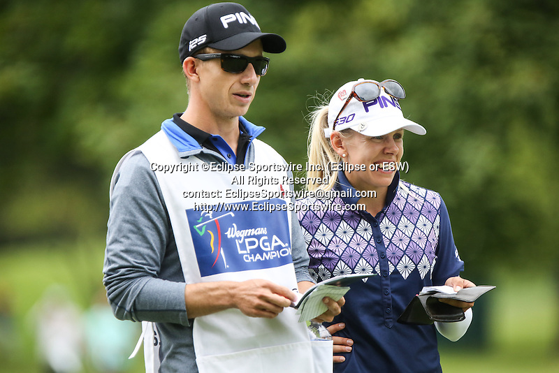 Pernilla Lindberg (right) and her caddie (left) review the 8th tee at the LPGA Championship 2014 Sponsored By Wegmans at Monroe Golf Club in Pittsford, New York on August 16, 2014