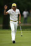 7 September 2008:    Camilo Villegas of Medellin, Colombia, South America waves to the crowd on the ninth hole after finishing the delayed third round of play and taking the lead at 13 under par at the BMW Golf Championship at Bellerive Country Club in Town & Country, Missouri, a suburb of St. Louis, Missouri on Sunday September 7, 2008. He and 23 other golfers had to finish their third round of competition Sunday morning before the fourth and final round could be played due to the suspension of third round play because of darkness on Saturday Sept. 6.  The BMW Championship is the third event of the PGA's  Fed Ex Cup Tour.