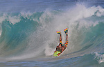 A boarder finds the perfect wave at Sandy Beach in Hawaii.