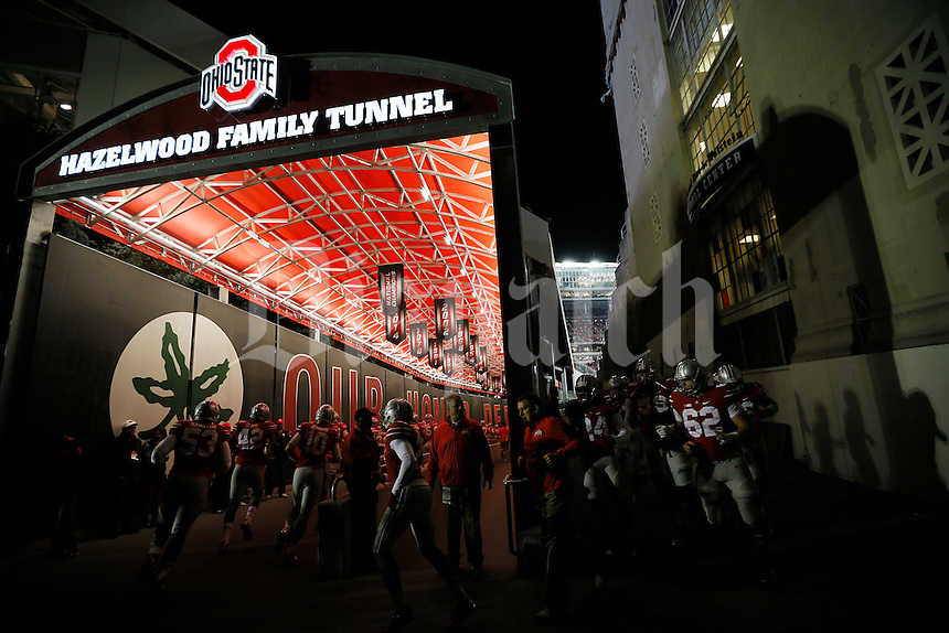 The Ohio State Buckeyes head to the field for warm ups before the college football game between the Ohio State Buckeyes and the Minnesota Golden Gophers at Ohio Stadium in Columbus, Saturday night, November 7, 2015. (The Columbus Dispatch / Eamon Queeney)