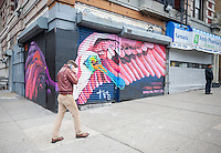 A mural of a Roseate Spoonbill by Danielle Mastrion, part of the Audubon Mural Projects decorates a store gate in Washington Heights in New York on Sunday, February 21, 2016. The murals decorating the buildings and storefronts show climate threatened birds and are meant to create public awareness of the threats against the various species of birds. (© Richard B. Levine)