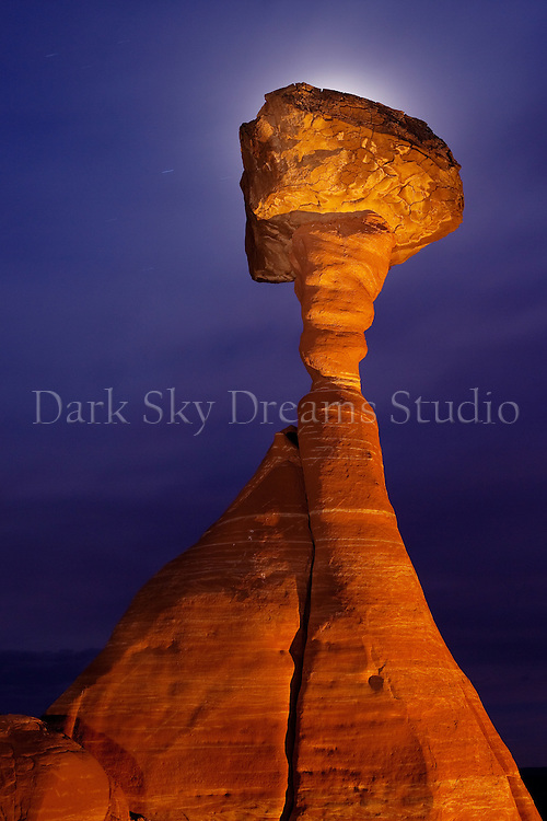 The moon rises behind a mushroom rock hoodoo in the Rimrock Toadstool BLM area near the Paria Contact Station, located between Kanab, Utah and Page, Arizona