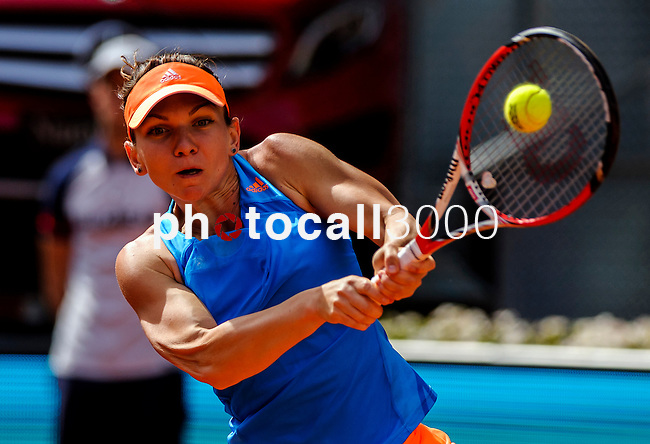 """Romanian tennis player Simona Halep returns a ball to Russian tennis player Maria Sharapova during their women's singles final tennis match of the Madrid Masters at the """"Caja Magica"""" sports complex in Madrid on May 11, 2014.<br /> <br /> Photocall3000/Daniel Calleja"""
