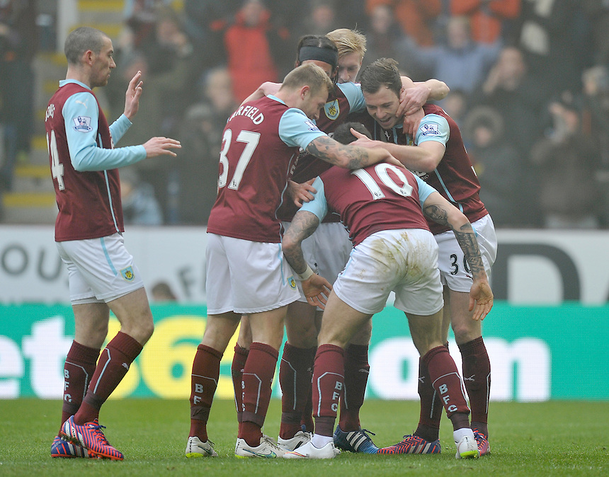 Burnley's Ashley Barnes is congratulated by team mates after scoring his sides opening goal<br /> <br /> Photographer Dave Howarth/CameraSport<br /> <br /> Football - Barclays Premiership - Burnley v West Bromwich Albion - Sunday 8th February 2015 - Turf Moor - Burnley<br /> <br /> &copy; CameraSport - 43 Linden Ave. Countesthorpe. Leicester. England. LE8 5PG - Tel: +44 (0) 116 277 4147 - admin@camerasport.com - www.camerasport.com