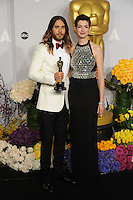 Jared Leto &amp; Anne Hathaway at the 86th Annual Academy Awards at the Dolby Theatre, Hollywood.<br /> March 2, 2014  Los Angeles, CA<br /> Picture: Paul Smith / Featureflash