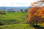 Hilltop Farm in Afternoon Sunshine during Fall Season in Walpole, New Hampshire USA