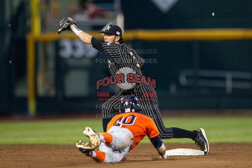 Vanderbilt Commodores shortstop Dansby Swanson (7) awaits the throw as Cal State Fullerton Titans baserunner Josh Vargas (40) slides into second during the NCAA College baseball World Series on June 14, 2015 at TD Ameritrade Park in Omaha, Nebraska. The Titans were leading 3-0 in the bottom of the sixth inning when the game was suspended by rain. (Andrew Woolley/Four Seam Images)
