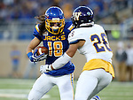 BROOKINGS, SD - SEPTEMBER 24:  Connor Landberg #18 from South Dakota State University looks to make a move against Mike Viti #26 from Western Illinois in the first half of their game Saturday evening at Dana J. Dykhouse Stadium in Brookings. (Photo by Dave Eggen/Inertia)