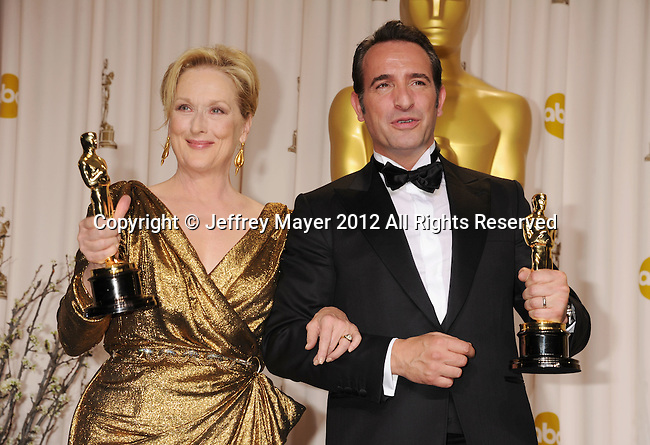 HOLLYWOOD, CA - FEBRUARY 26: Meryl Streep and Jean Dujardin pose in the press room at the 84th Annual Academy Awards held at Hollywood & Highland Center on February 26, 2012 in Hollywood, California.