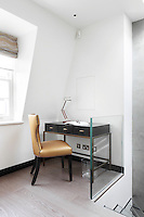 A compact space at the top of the stairwell has been neatly utilised with a smart desk and chair