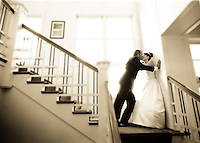 A bride and groom share a passionate kiss on the stairwell on their wedding day. (Photo by Scott Eklund/Red Box Pictures)