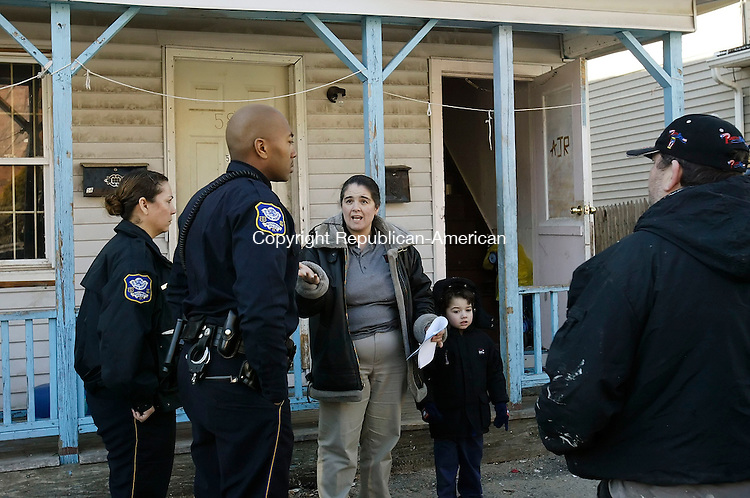 WATERBURY, CT. 09 FEBRUARY 2006-020906BZ04- Waterbury Police talk to a neighbor (ROBYN ADAMS HAS ID) in front of 588 Baldwin St. Thursday afternoon after the untimely death of an infant was reported.  <br /> Jamison C. Bazinet / Republican-American