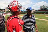 """Catcher Tomas Nido #16 talks with Hall of Fame Cubs legend Ernie Banks, aka """"Mr. Cub"""" before the Under Armour All-American Game at Wrigley Field on August 13, 2011 in Chicago, Illinois.  (Mike Janes/Four Seam Images)"""