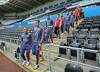 (L-R) Leon Britton and Gylfi Sigurdsson of Swansea  lead team mates down the stand prior to the Barclays Premier League match between Swansea City and Arsenal at the Liberty Stadium, Swansea on October 31st 2015