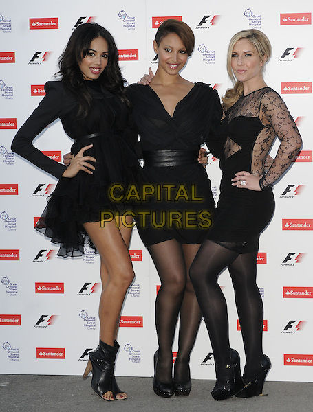 JADE EWEN, AMELLE BERRABAH & HEIDI RANGE of Sugababes.The F1 Party held at the Natural History Museum, London, England, UK..5th July 2010.Formula one full length black dress band group hand on hip mini lace sheer see thru through fishnet body con Formula one open toe ankle boots tights .CAP/CAN.©Can Nguyen/Capital Pictures.