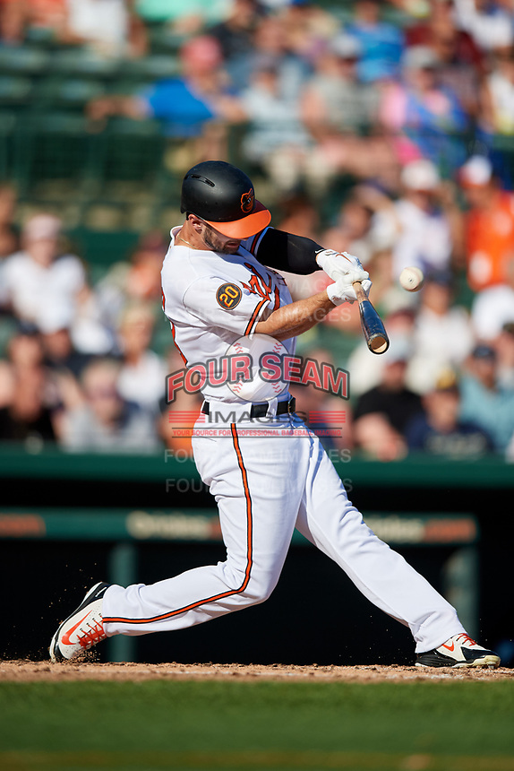Baltimore Orioles center fielder Joey Rickard (23) follows through on a swing during a Grapefruit League Spring Training game against the Detroit Tigers on March 3, 2019 at Ed Smith Stadium in Sarasota, Florida.  Baltimore defeated Detroit 7-5.  (Mike Janes/Four Seam Images)