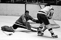 Seals vs Chicago Black Hawks 1970. Seals Earl Ingarfield against Black Hawks goalie Gerry Desjardins. (1970 photo/Ron Riesterer)