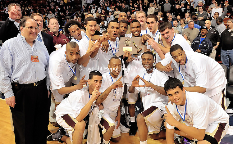 UNCASVILLE, CT-21 MARCH 2009-032109JS11-- Sacred Heart boys basketball team poses for a team photo with Waterbury Mayor Michael J. Jarjura, a Sacred Heart alumn, after capturing the CIAC Class M state championship at the Mohegan Sun Arena. <br /> Jim Shannon Republican-American