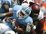 09 September 2006: North Carolina's Barrington Edwards (blue) is tackled by Virginia Tech's Xavier Adibi (behind). The University of North Carolina Tarheels lost 35-10 to the Virginia Tech Hokies at Kenan Stadium in Chapel Hill, North Carolina in an Atlantic Coast Conference NCAA Division I College Football game.